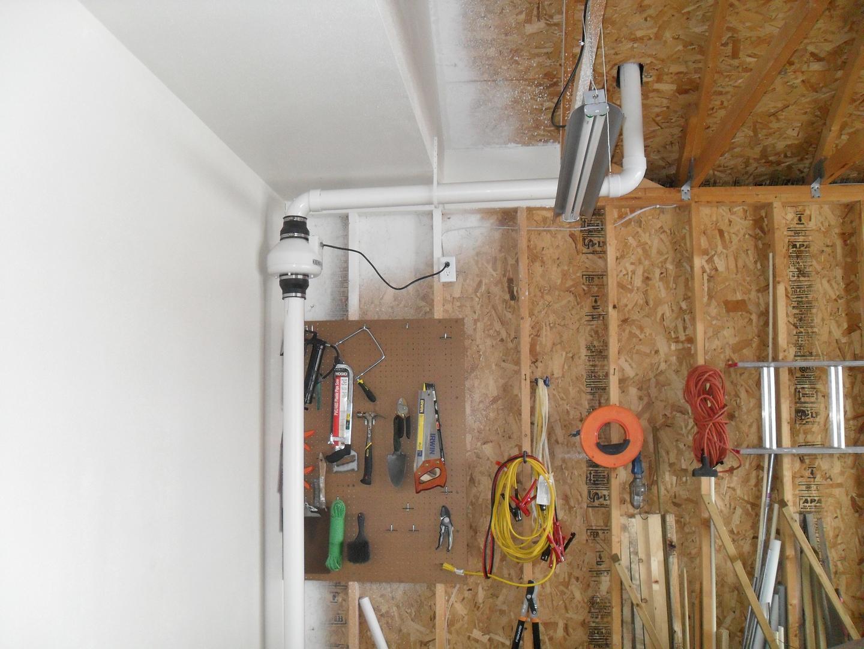 Radon mitigation fan installation in home garage